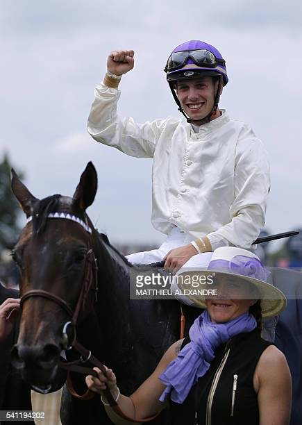 Italian jockey Cristian Demuro celebrates after coming in first on La Cressonniere during the 167th 'Prix de Diane' a 2100metre flat horse race on...