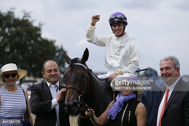 Italian jockey Cristian Demuro flanked by French horse trainer and former jockey JeanClaude Rouget celebrates after coming in first on La...