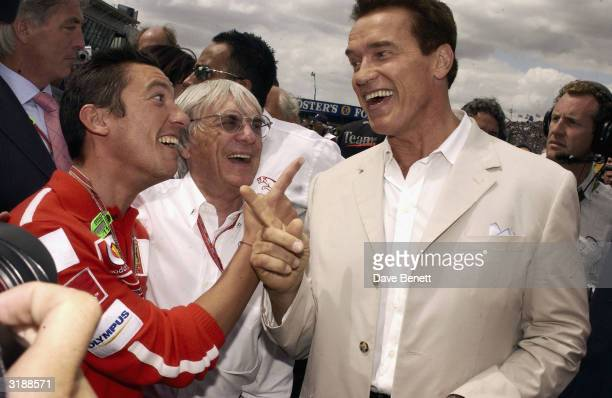 Italian jockey Frankie Dettori and Austrian/American actor Arnold Schwarzenegger attends the British Formula One 'Paddocklife' event on July 20 2003...