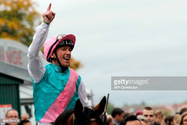 Italian Jockey Lanfranco Dettori aka Frankie Dettori celebrates after winning the Qatar Prix de l'Arc de Triomphe horse race at the Chantilly...