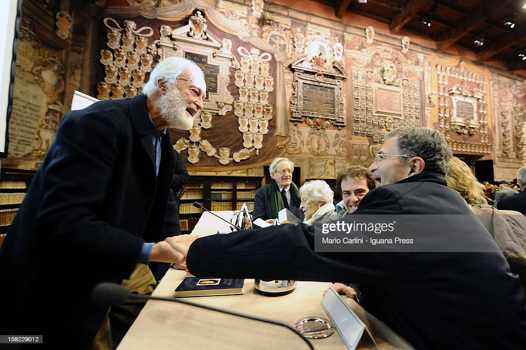 Italian journalist and author Eugenio Scalfari (L) meets <a gi-track='captionPersonalityLinkClicked' href=/galleries/search?phrase=Romano+Prodi&family=editorial&specificpeople=203301 ng-click='$event.stopPropagation()'>Romano Prodi</a> former Prime Minister of Italian Government during the presentation of his latest book 'La Passione dell'Etica' at Stabat Mater Archiginnasio on December 11, 2012 in Bologna, Italy.