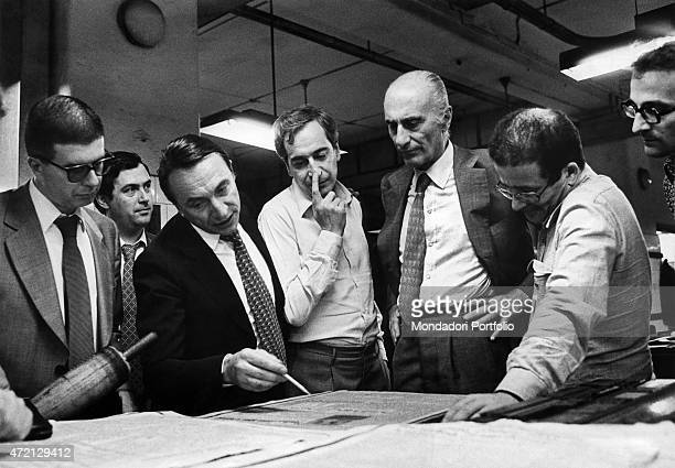 'Italian journalist and editor in chief of Il Giornale Nuovo Indro Montanelli looking at the proof of the first page of the newspaper with Italian...
