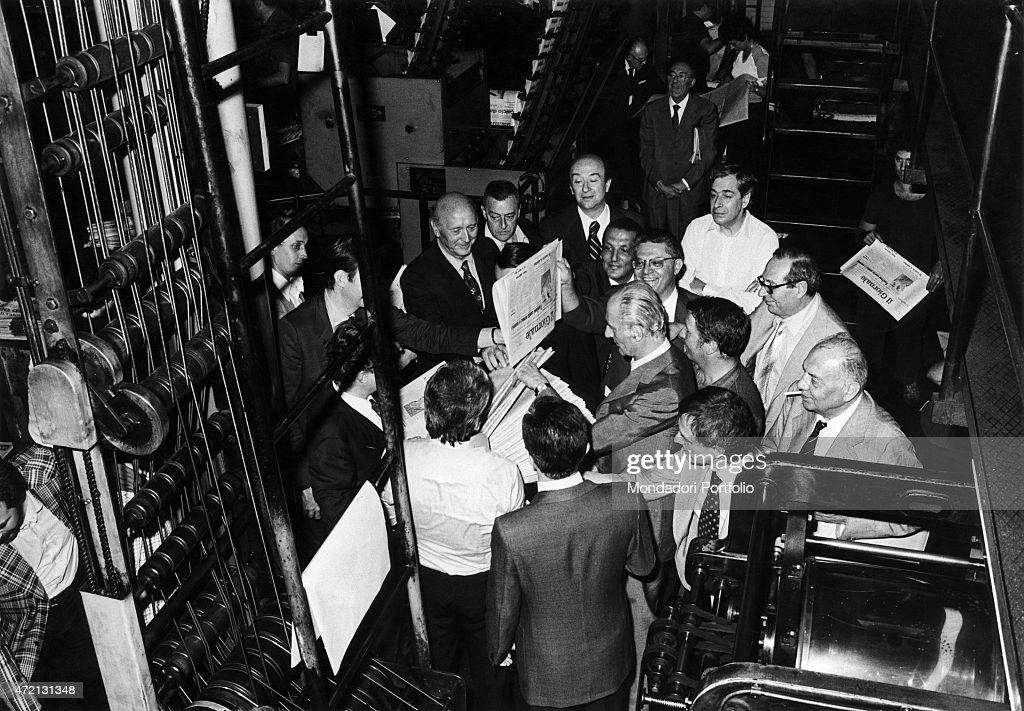 'Italian journalist and editor in chief of Il Giornale Nuovo Indro Montanelli looking at the first copy of the newspaper beside the rotary presses...
