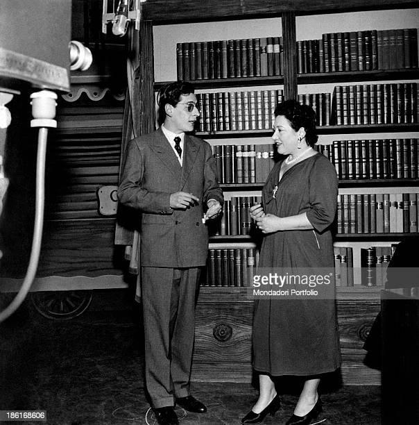 Italian journalist and politician Enzo Bettiza talking with Italian soprano Mafalda Favero 1950s