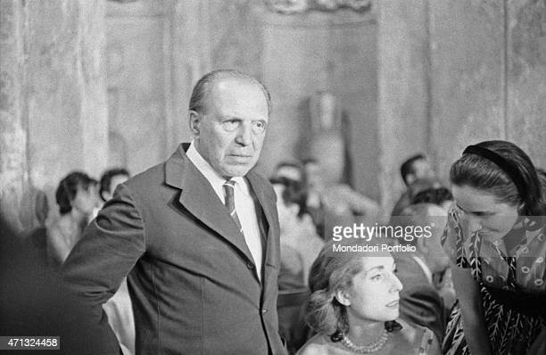 Italian journalist and writer Paolo Monelli attending the gala evening of the 12th Strega Prize at Villa Giulia nymphaeum with his future wife and...