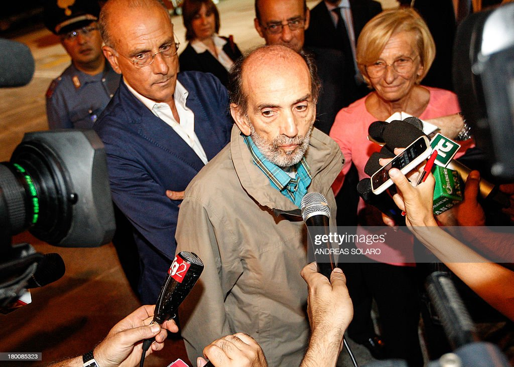 Italian journalist Domenico Quirico (C), who was kidnapped in Syria in early April, answers to journalists after disembark from the airplane on September 9, 2013 at Ciampino military airport in Rome.