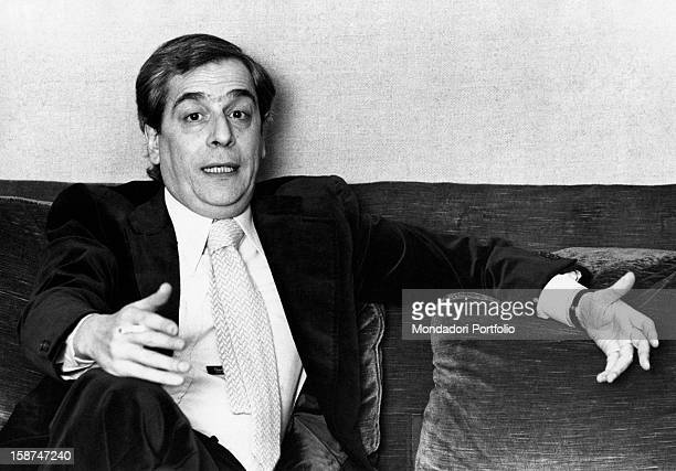 Italian journalist Enzo Bettiza sitting on a couch and speaking Milan 1974