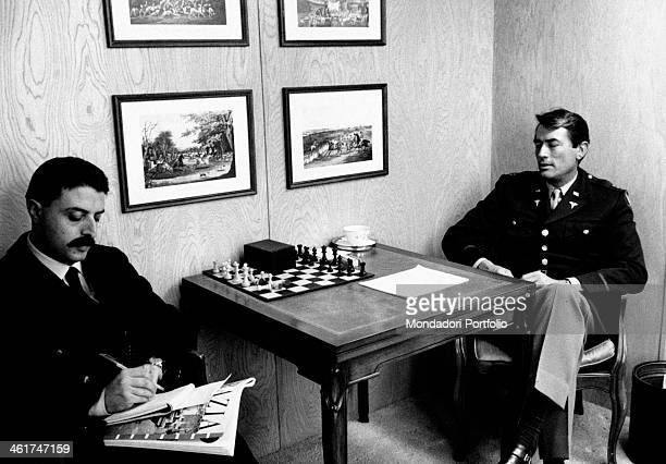 Italian journalist Giorgio Torelli interviewing American actor Gregory Peck inside his caravan while shooting the film Captain Newman MD Hollywood...