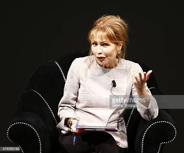Italian journalist Lilli Gruber speaks on May 30 2015 at the Economics Festival of Economics in Trento AFP PHOTO / PIERRE TEYSSOT