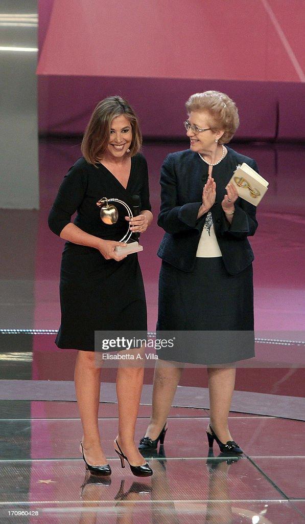 Italian journalist Maria Latella (L) receives Bellisario award from RAI President Anna Maria Tarantola attend Premio Bellisario 2013 at Dear RAI studios on June 20, 2013 in Rome, Italy.