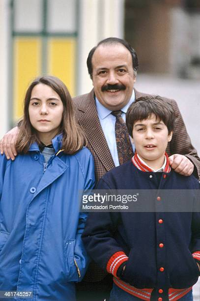 Italian journalist presenter TV author and scriptwriter Maurizio Costanzo posing with his children Camilla and Saverio Italy 1986