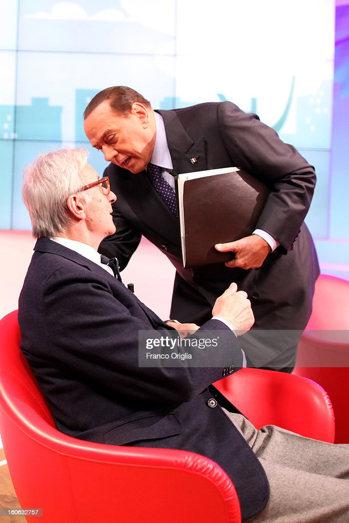 Italian journalist Vittorio Feltri (L) and <a gi-track='captionPersonalityLinkClicked' href=/galleries/search?phrase=Silvio+Berlusconi&family=editorial&specificpeople=201842 ng-click='$event.stopPropagation()'>Silvio Berlusconi</a> (R) attend 'L'Aria Che Tira' TV show on February 4, 2013 in Rome, Italy. <a gi-track='captionPersonalityLinkClicked' href=/galleries/search?phrase=Silvio+Berlusconi&family=editorial&specificpeople=201842 ng-click='$event.stopPropagation()'>Silvio Berlusconi</a> has announced yesterday that if the PDL party (People of the Liberty) win the elections scheduled for February 24, they will return the tax to families introduced by the government of Mario Monti.