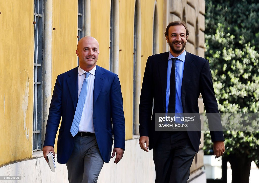 Italian journalists Gianluigi Nuzzi and Emiliano Fittipaldi leave Vatican city on July 7 2016 after a verdict in the 'Vatileaks' trial The two...