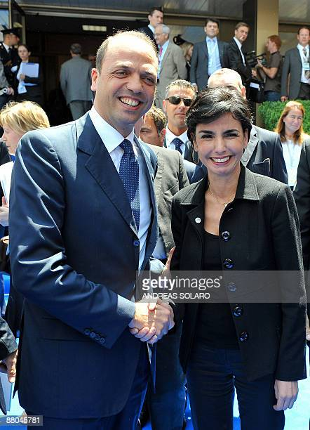 Italian Justice minister Angelino Alfano shakes hands with French Justice Minister Rachida during a break of a Group of eight Justice and Home...