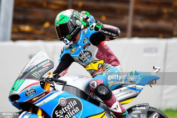 Italian Kalex rider Franco Morbidelli celebrates winning the Moto2 competition of the Moto Grand Prix of Germany at the Sachsenring Circuit on July 2...