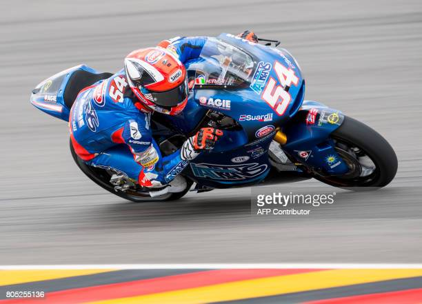 Italian Kalex rider Mattia Pasini steers his bike during a training session of the Moto2 of the Grand Prix of Germany at the Sachsenring Circuit on...