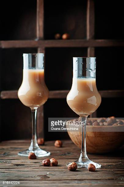 Italian liqueur with hazelnut on the wooden table