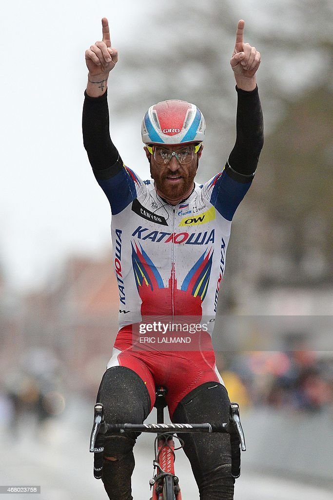 Italian <a gi-track='captionPersonalityLinkClicked' href=/galleries/search?phrase=Luca+Paolini&family=editorial&specificpeople=774515 ng-click='$event.stopPropagation()'>Luca Paolini</a> of Team Katusha celebrates as he crosses and win the 77th edition of the Gent-Wevelgem one day cycling race on March 29, 2015 in Wevelgem. AFP PHOTO / BELGA PHOTO / ERIC LALMAND **BELGIUM OUT**