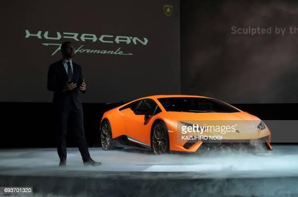 Italian luxury car maker Automobili Lamborghini Japan managingdirector Francesco Cresci introduces the company's new model Lamborghini Huracan...