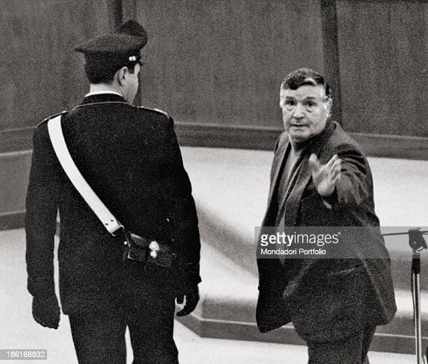 Italian mafioso Totò Riina gesticulating in a courtroom during the trial in which he faces the charge of having been the head of the mafia...