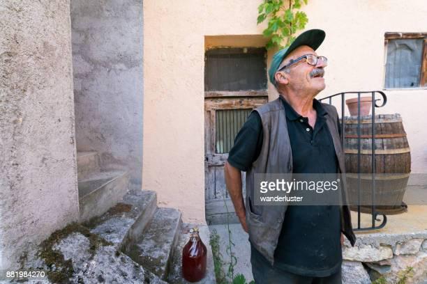 Italian man at his wine cellar