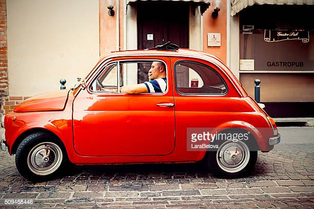 Italian man driving car and using phone
