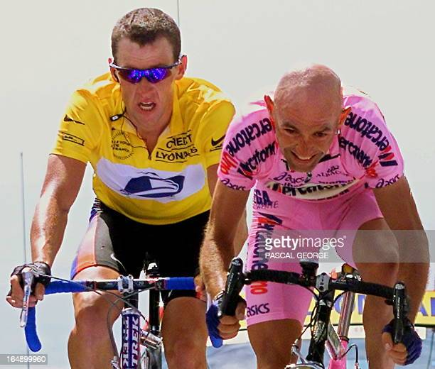 Italian Marco Pantani wins the 12th stage of the 87th Tour de France ahead of the yellow jersey US Lance Armstrong at the Mont Ventoux southern...