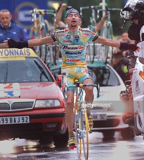 Italian Marco Pantani wins the 15th stage of the Tour de France in Les Deux Alpes southern France 27 July and becomes the new yellow jersey AFP PHOTO