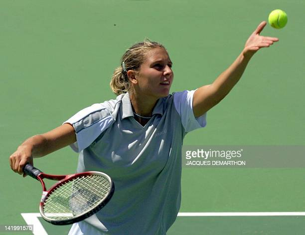 Italian Maria Elena Camerin performs a service at French Amelie Mauresmo 21 July 2001 during their FedCup match in Vittel Mauresmo won 64 60...