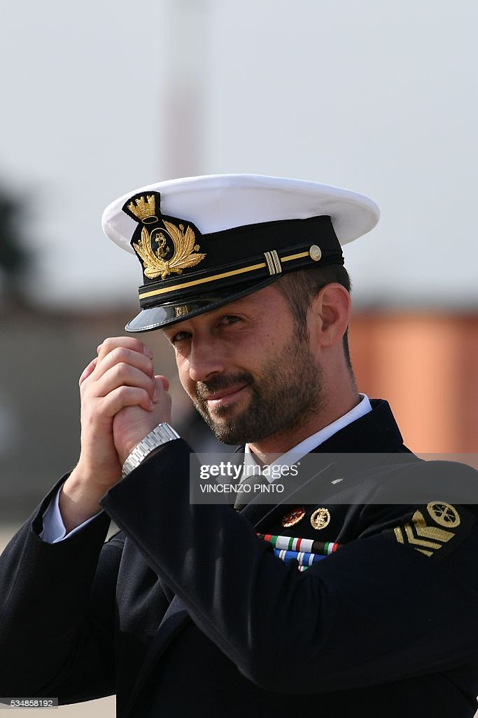 Italian Marine Salvatore Girone arrives on May 28, 2016 at the Ciampino airport in Rome. India's top court on May 26, 2016 allowed Girone accused of killing two fishermen to return home pending a ruling on where he should be tried in a long-running case that has soured ties between the two countries. Salvatore Girone and fellow marine Massimiliano Latorre are accused of shooting the fishermen while protecting an Italian oil tanker as part of an anti-piracy mission off India's southern Kerala coast in 2012. / AFP / VINCENZO