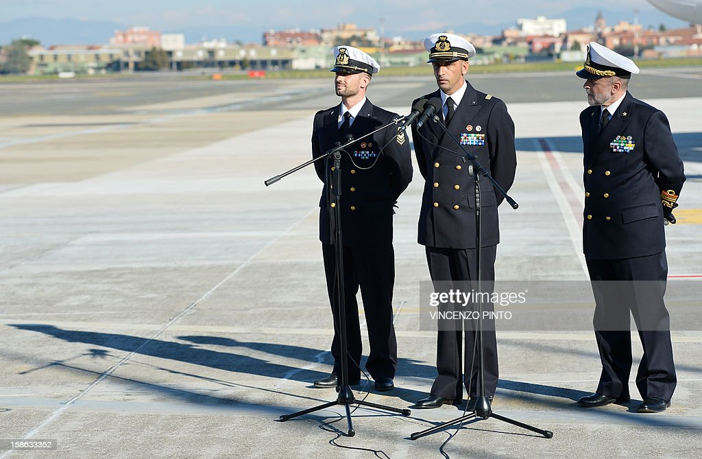 Italian marines Massimiliano Latorre ( C ) and Salvatore Girone ( L ) address the press beside Admiral Luigi Binelli Mantelli ( R ) upon their arrival at Ciampino's airport on December 22, 2012. An Indian court allowed two Italian marines awaiting trial for shooting two fishermen to go home for Christmas, despite prosecution fears that they will not return. The marines shot dead the fishermen off India's southwestern coast near the port city of Kochi in February while guarding an Italian oil tanker, but they deny murder on the grounds that they mistook their victims for pirates.