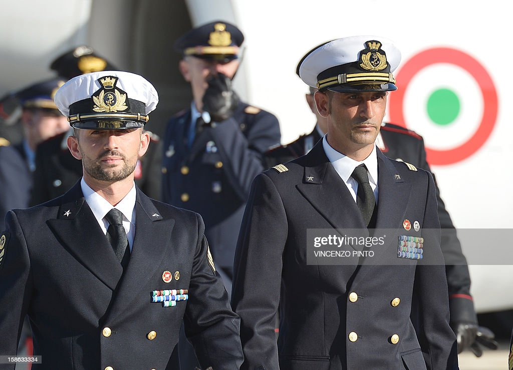 Italian marines Massimiliano Latorre ( R ) and Salvatore Girone ( L ) arrive at Ciampino airport near Rome, on December 22, 2012.An Indian court allowed two Italian marines awaiting trial for shooting two fishermen to go home for Christmas, despite prosecution fears that they will not return. The marines shot dead the fishermen off India's southwestern coast near the port city of Kochi in February while guarding an Italian oil tanker, but they deny murder on the grounds that they mistook their victims for pirates.