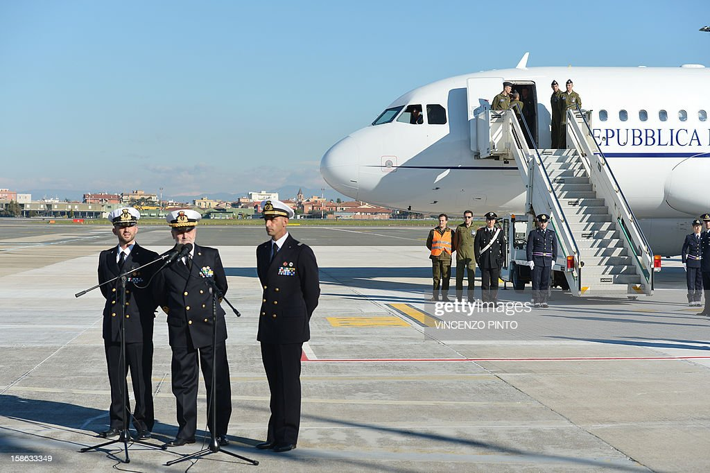 Italian marines Massimiliano Latorre (R) and Salvatore Girone (L) flank Admiral Luigi Binelli Mantelli (C) at Ciampino airport near Rome, on December 22, 2012.An Indian court allowed two Italian marines awaiting trial for shooting two fishermen to go home for Christmas, despite prosecution fears that they will not return. The marines shot dead the fishermen off India's southwestern coast near the port city of Kochi in February while guarding an Italian oil tanker, but they deny murder on the grounds that they mistook their victims for pirates.