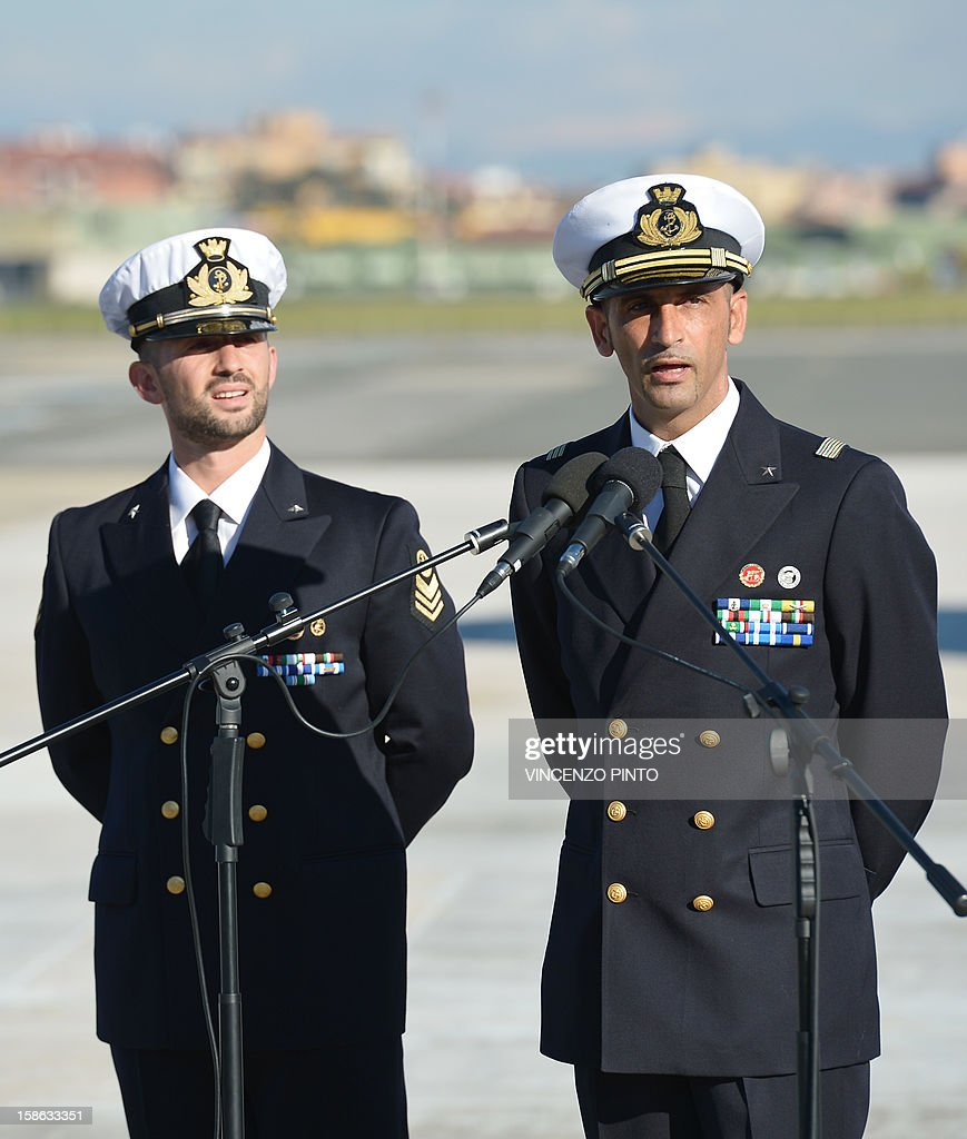 Italian marines Massimiliano Latorre (R) and Salvatore Girone (L) speak to the press at Ciampino airport near Rome, on December 22, 2012.An Indian court allowed two Italian marines awaiting trial for shooting two fishermen to go home for Christmas, despite prosecution fears that they will not return. The marines shot dead the fishermen off India's southwestern coast near the port city of Kochi in February while guarding an Italian oil tanker, but they deny murder on the grounds that they mistook their victims for pirates.