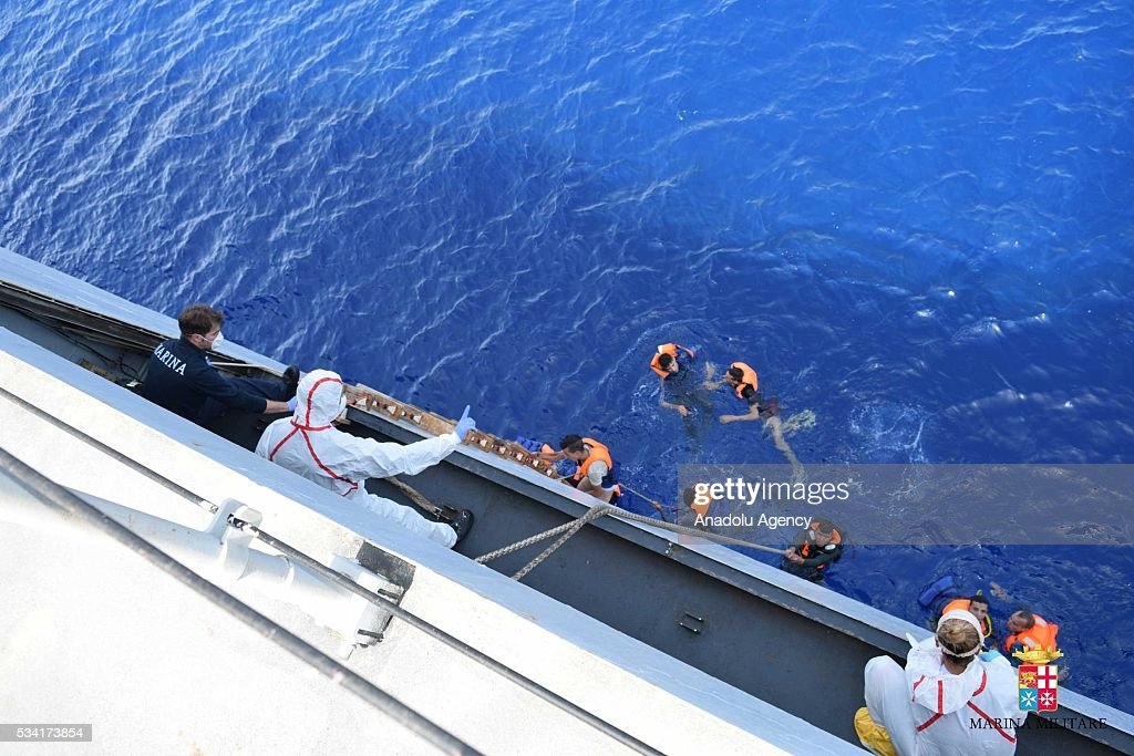 Italian marines rescue migrants from a capsized boat at Sicilian Strait, between Libya and Italy, in Mediterranean sea on May 25, 2016. The Italian Navy saved around 500 migrants as they found dead bodies of seven migrants in the sea during the operations.
