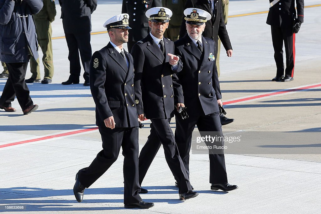 Italian marines Salvatore Girone, Massimiliano Latorre and Luigi Binelli Mantelli Chief of Staff of the Navy arrive at Ciampino Airport on December 22, 2012 in Rome, Italy. The two marines were granted leave on licence by a court in India, so that they could spend Christmas at home in Italy with their families. The two sailors are charged with killing two fishermen off the coast of India and are awaiting trial.