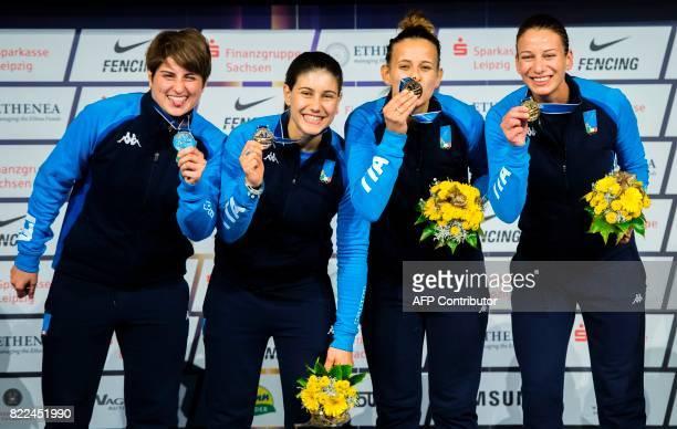 Italian Martina Crisitio Loreta Gulotta Rossella Gregorio and Irene Vecci celebrate on the podium after winning the team women's sabre final between...