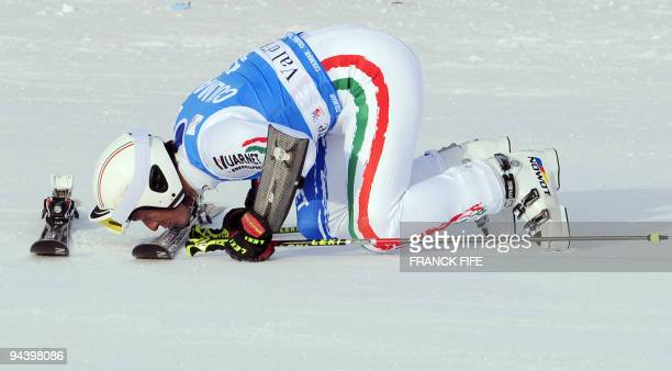 Italian Massimiliano Blardone kisses his skis after taking the 2th place in the finish area of the FIS World Cup Men's Giant Slalom on December 13...