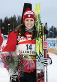 Italian Michaela Ponza poses after placing fourth in the women's World Cup biathlon 10 kms pursuit in Oestersund Sweden 18 December 2004 Russian Olga...