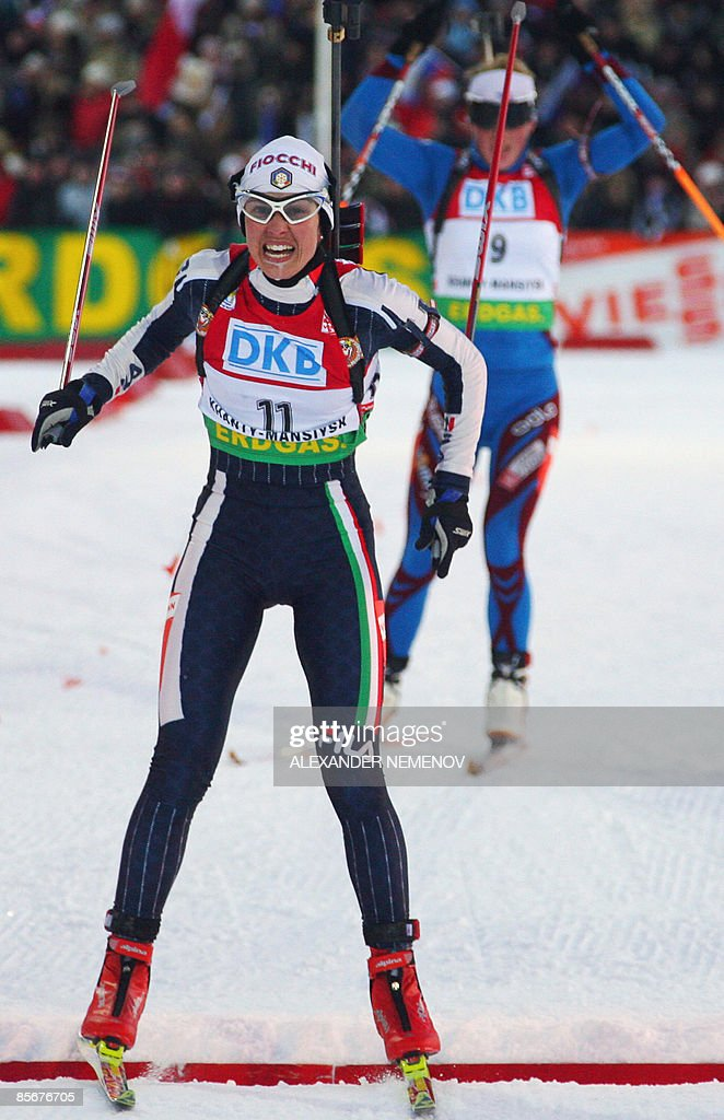 Italian Michela Ponza crosses the finish line in second place as French Marie Dorin follows in third during the women's 10 km sprint at the World Cup...