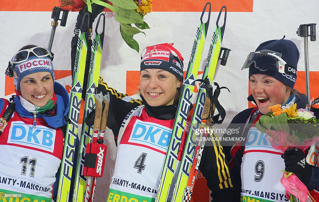 Italian Michela Ponza winner German Magdalena Neuner and French Marie Dorin jubilate on the podium after the World Cup biathlon women's 10 km pursuit...
