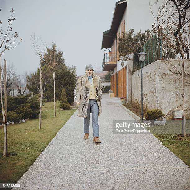 Italian middleweight boxer Nino Benvenuti holder of the WBA and WBC middleweight titles pictured wearing a fur coat and hat outside his house in...