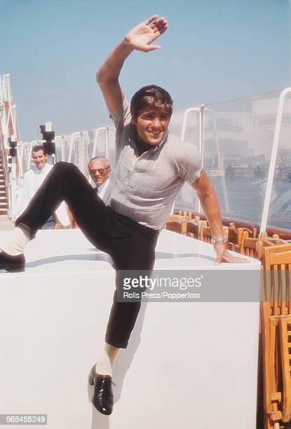 Italian middleweight boxer Nino Benvenuti pictured waving to spectators circa 1968