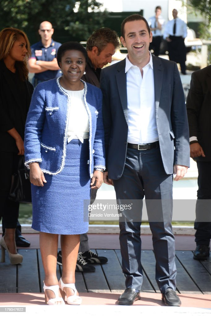 Italian minister <a gi-track='captionPersonalityLinkClicked' href=/galleries/search?phrase=C%C3%A9cile+Kyenge&family=editorial&specificpeople=10908084 ng-click='$event.stopPropagation()'>Cécile Kyenge</a> and Vincenzo Spadafora are seen during the 70th Venice International Film Festival on September 2, 2013 in Venice, Italy.