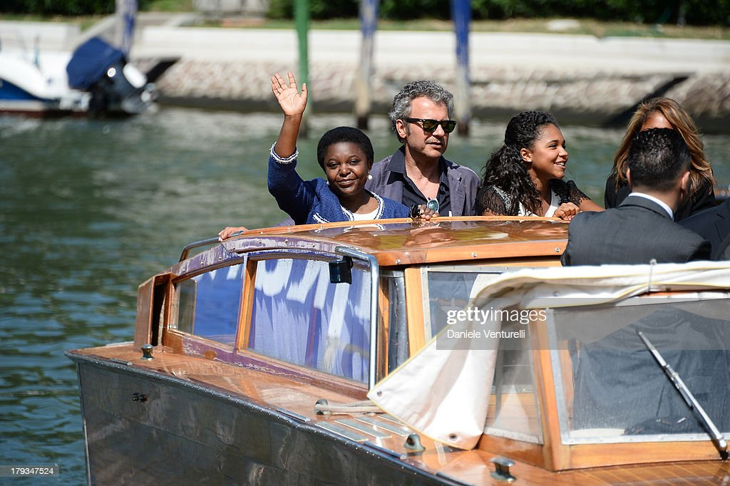 Italian minister <a gi-track='captionPersonalityLinkClicked' href=/galleries/search?phrase=C%C3%A9cile+Kyenge&family=editorial&specificpeople=10908084 ng-click='$event.stopPropagation()'>Cécile Kyenge</a>, her husband Domenico Grispino and her daughters Maisha and Giulia are seen during the 70th Venice International Film Festival on September 2, 2013 in Venice, Italy.