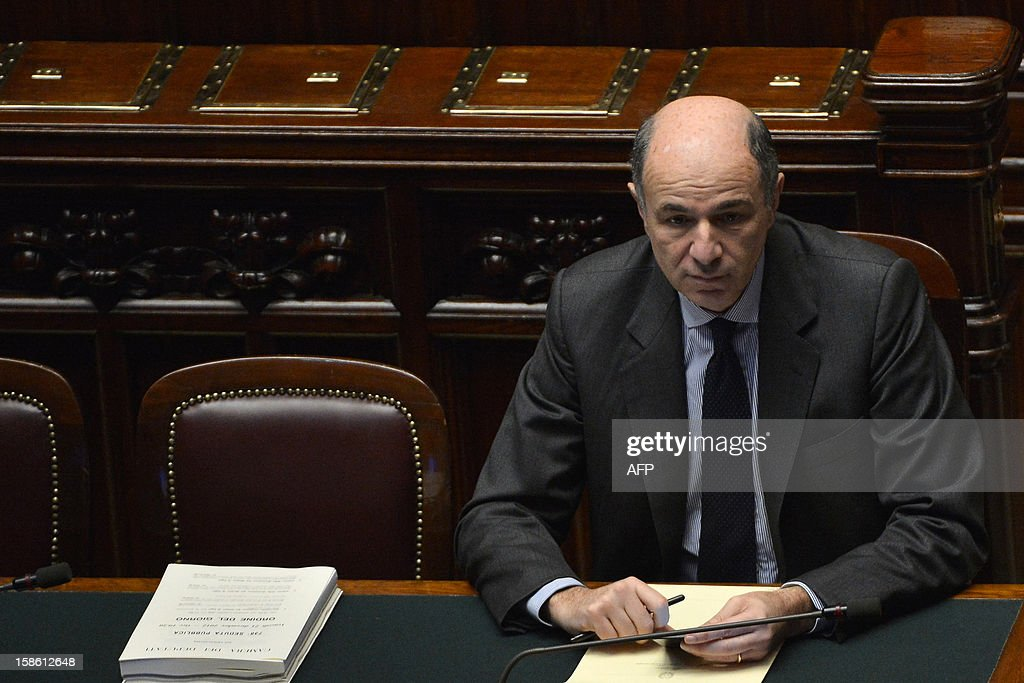 Italian minister for economic development Corrado Passera takes place for the a session on a key budget vote on December 21, 2012 at the parliement in Rome. The Italian parliament prepared Friday for a key budget vote which will trigger the resignation of Prime Minister Mario Monti, who is expected to reveal this weekend whether he will run in the upcoming election.