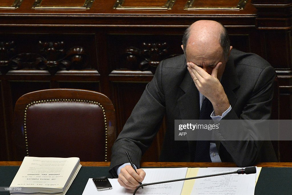 Italian minister for economic development Corrado Passera takes place for the a session on a key budget vote on December 21, 2012 at the parliament in Rome. The Italian parliament prepared Friday for a key budget vote which will trigger the resignation of Prime Minister Mario Monti, who is expected to reveal this weekend whether he will run in the upcoming election.