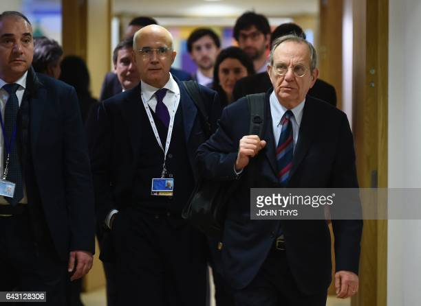 Italian Minister of Economy and Finance Pier Carlo Padoan arrives for an Eurogroup meeting at the EU headquarters in Brussels on February 20 2017 /...