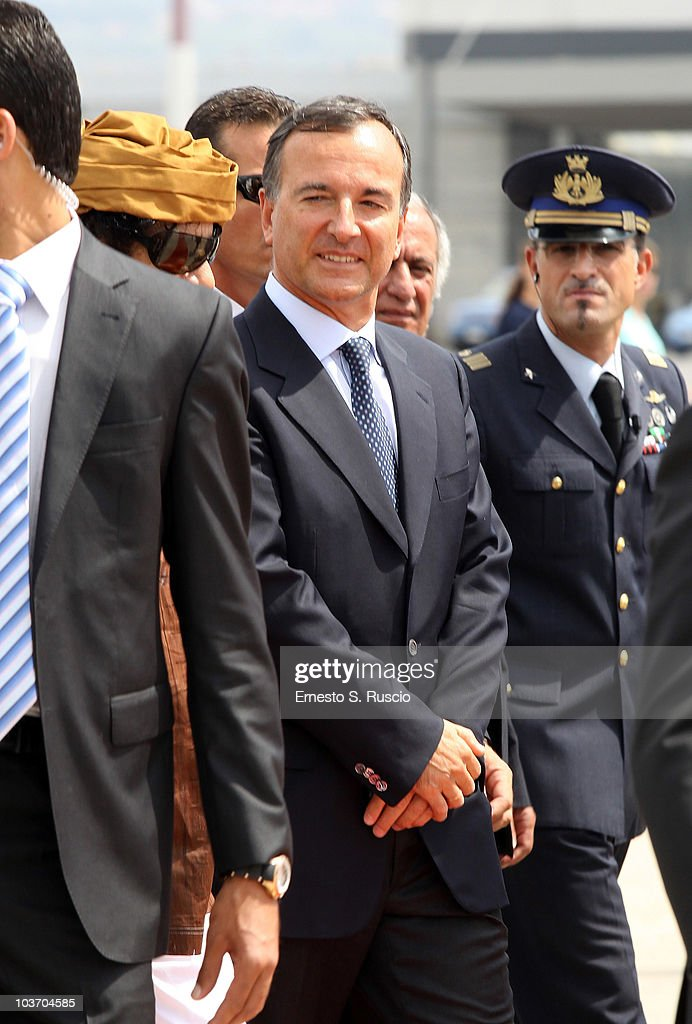 Italian Minister of Foreign Affairs <a gi-track='captionPersonalityLinkClicked' href=/galleries/search?phrase=Franco+Frattini&family=editorial&specificpeople=536993 ng-click='$event.stopPropagation()'>Franco Frattini</a> greets the Libyan Leader <a gi-track='captionPersonalityLinkClicked' href=/galleries/search?phrase=Muammar+Gaddafi&family=editorial&specificpeople=202172 ng-click='$event.stopPropagation()'>Muammar Gaddafi</a> at the Ciampino airport on August 29, 2010 in Rome, Italy. Gadaffi is on an official two-day visit to Italy for talks with Prime Minister Silvio Berlusconi. The visit also marks the second anniversary of a friendship treaty between Italy and Lybia.