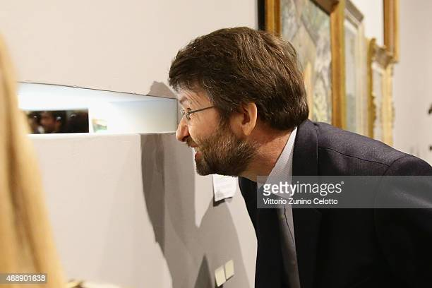 Italian Minister of Heritage Cultural Activity Dario Franceschini visits the Arts Foods Pavillion at Triennale di Milano on April 8 2015 in Milan...